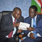 Prime Minister Raila Odinga consulting with Hon Magerer