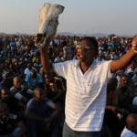 Striking South African miners cut wage demands