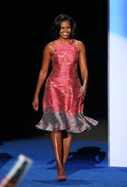Michelle Obama taking the pondium at the DNC 2012 in Challorte, Northern Carolina.