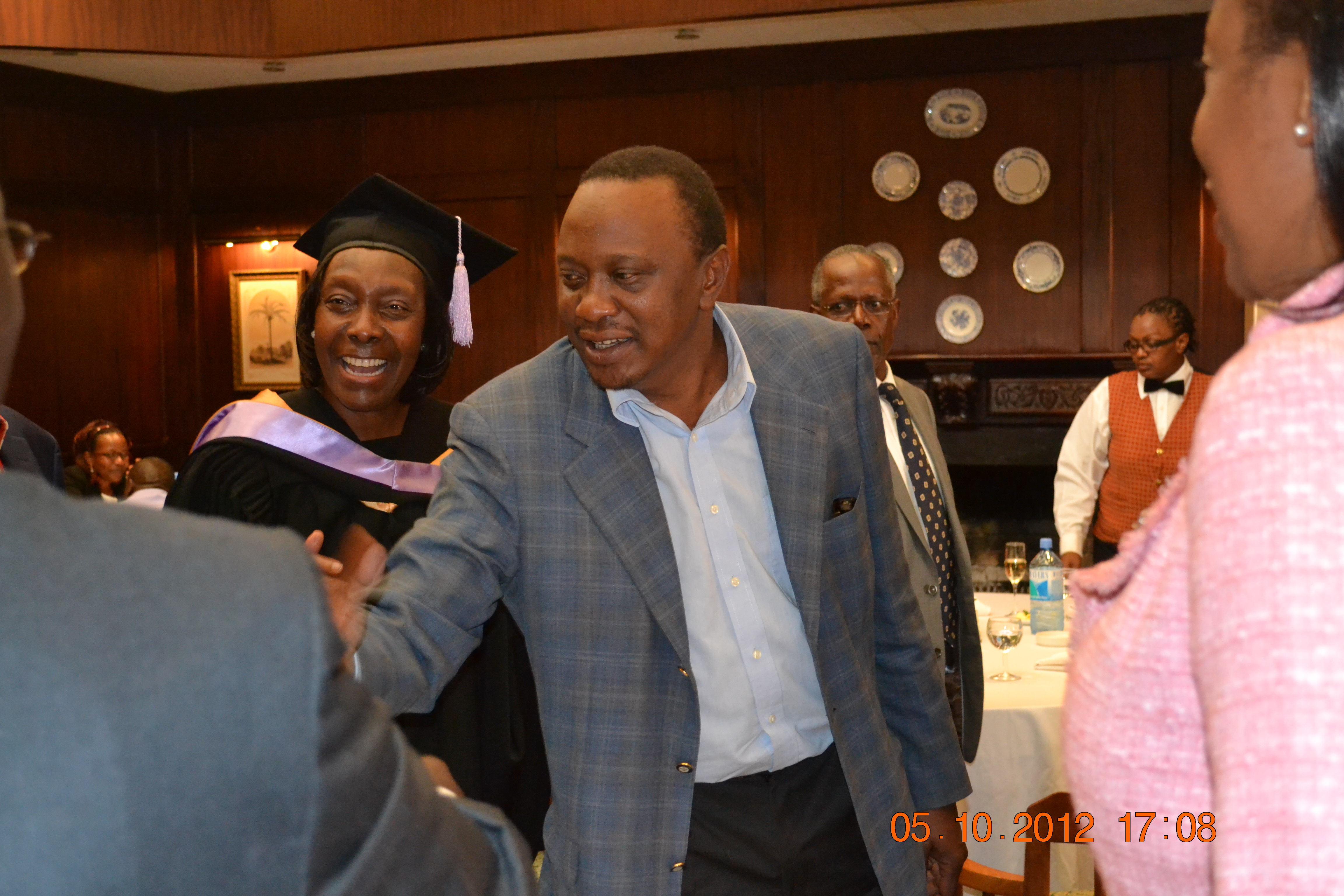 NARC leader Charity Ngilu introducing Uhuru to guests at her gradution dinner