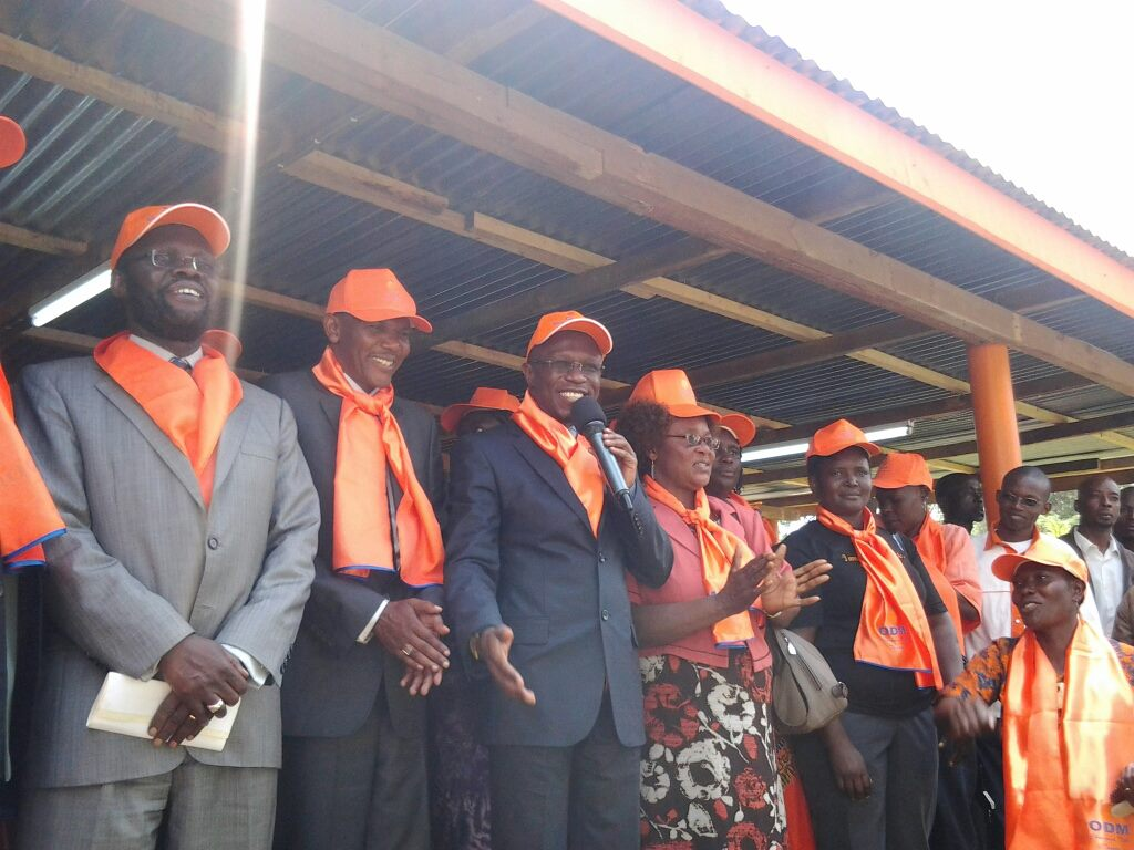 Hon Ababu Namwamba addressing New Ford Kenya and CCU officials who defected to ODM at Orange house