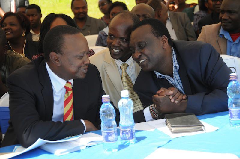 Uhuru Kenyatta and Gitobu Imanyara at a church service in Meru
