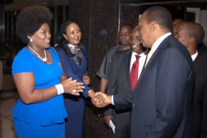 Lady Shebesh looks on as Pres. Uhuru Kenyatta greets Foreign Affairs Secretary Amb Amina Mohammed.