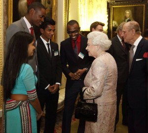 Kiziah, tallest, sharing a light moment with Queen Elizabeth.