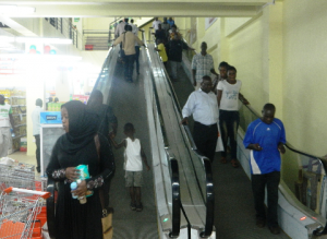 HILARIOUS: KISUMU residents throng NAIVAS SUPERMARKET to see first ever ESCALATOR in Luoland